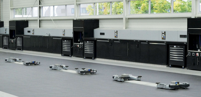 Black automotive tool cabinets in workshop by Dura Ltd