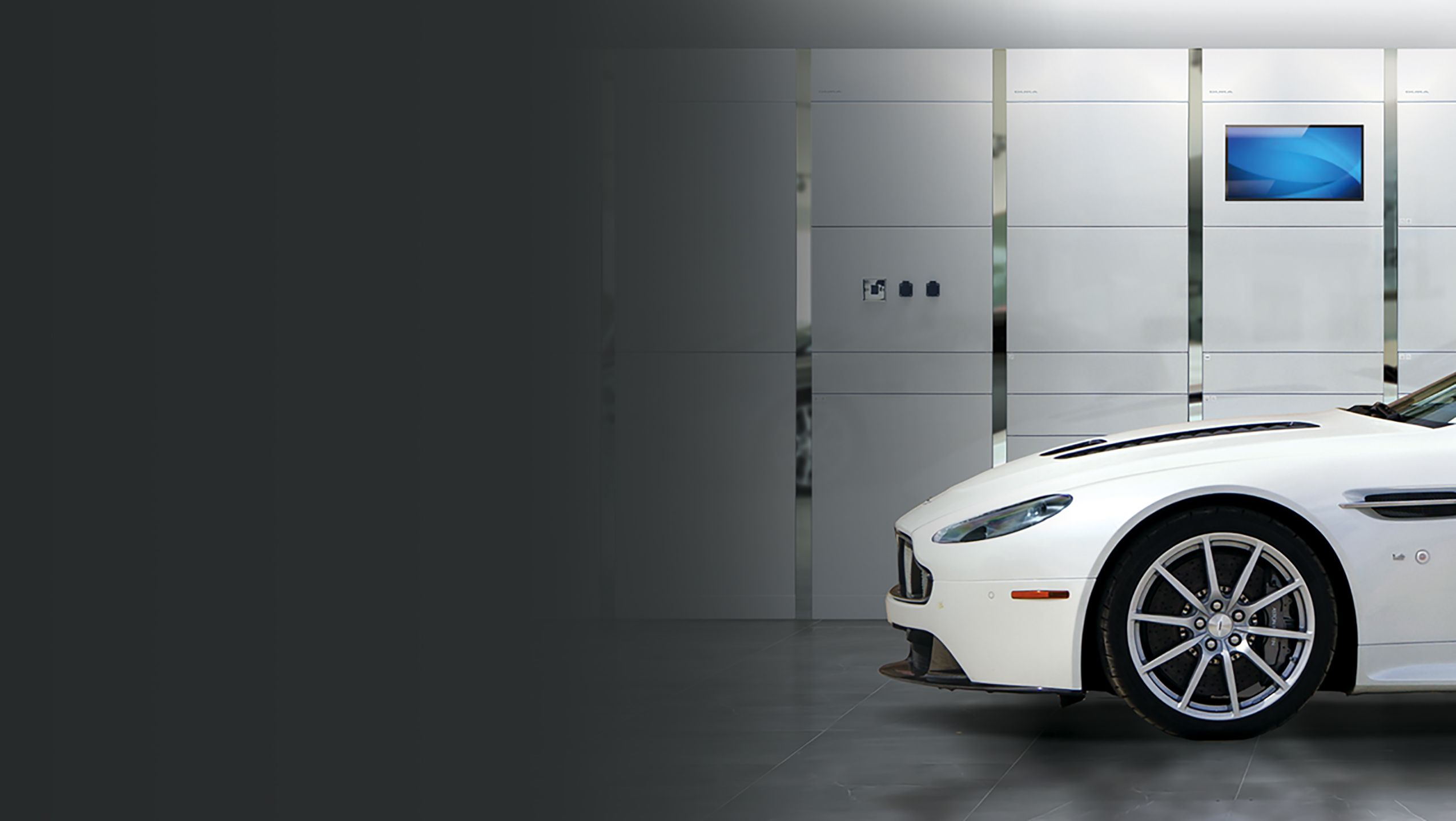 Modern white workshop furniture with Aston Martin