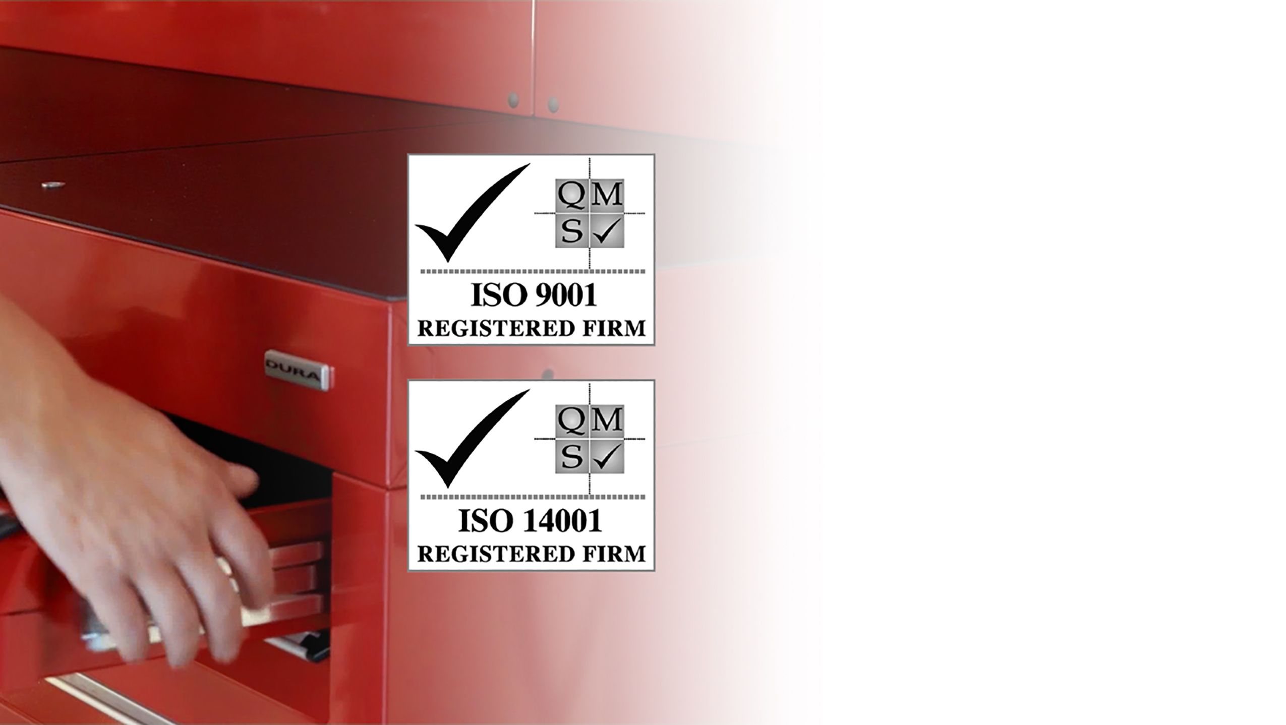 Drawer opening on red tool cabinets with ISO 9001/14001 logos